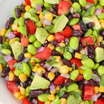 Vegan black bean avocado salad in a white bowl