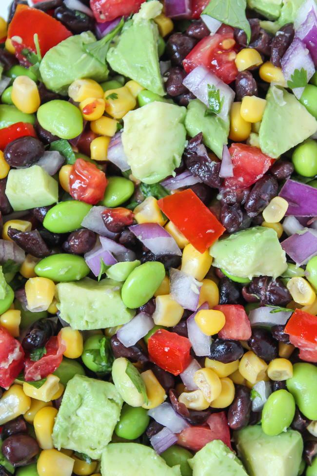 Close up view of black bean avocado salad with edamame
