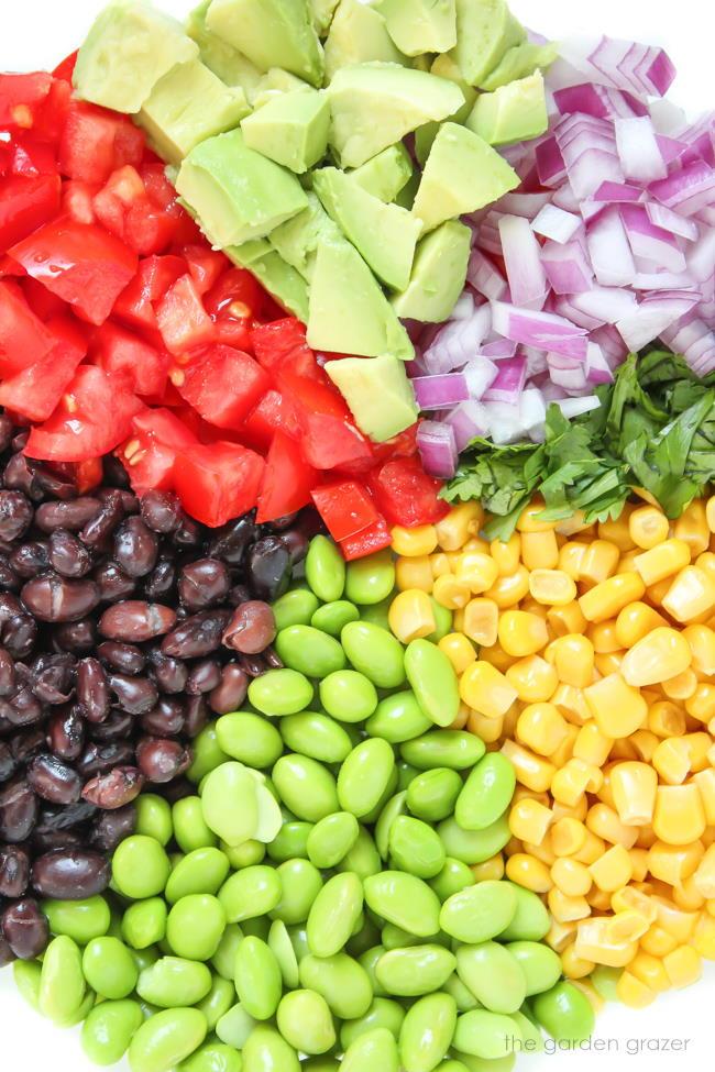 Ingredients for black bean avocado edamame salad in a bowl