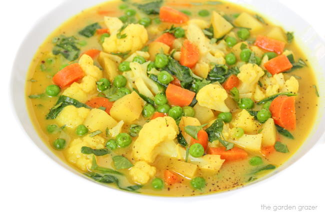 Coconut curry soup in a bowl with vegetables