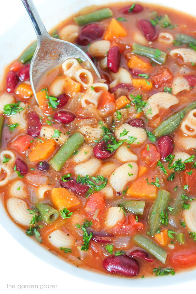 Bowl of vegan minestrone soup with kidney beans and pasta
