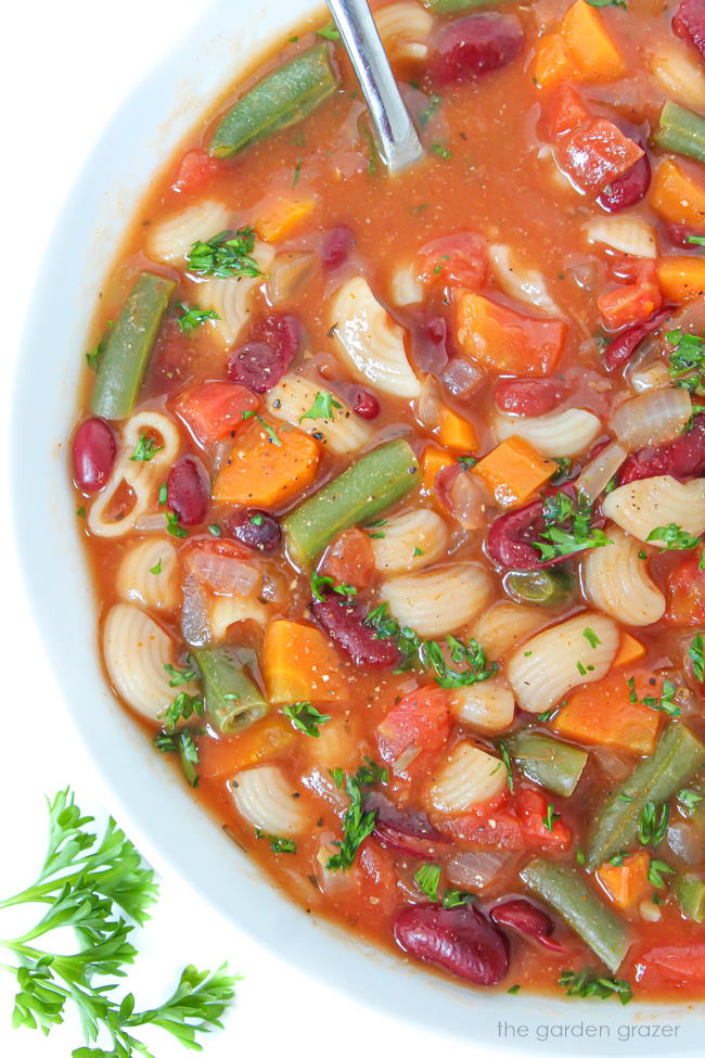 Healthy minestrone soup in a bowl with spoon