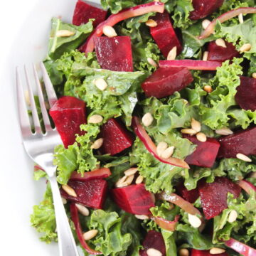 Balsamic Beet Kale salad on a plate with fork