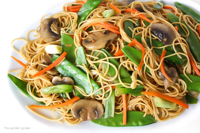 Plate of vegan Asian spaghetti with mushrooms