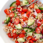 Vegan Greek Farro Salad in a bowl with spoon