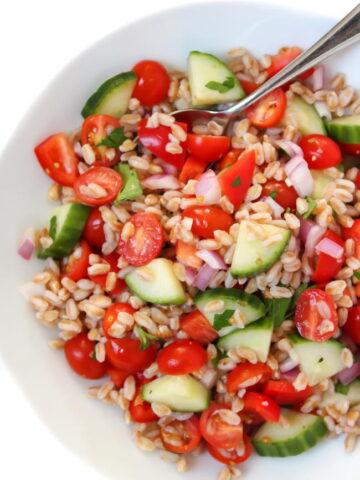 Vegan Greek Farro Salad in a bowl with spoon