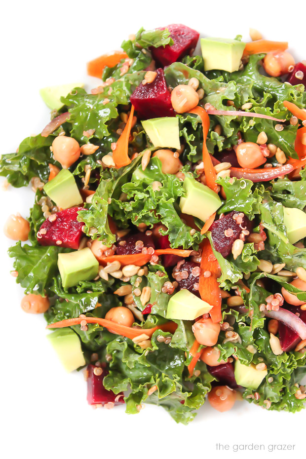 Kale superfood salad in a bowl with avocado and beets