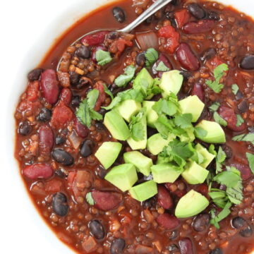 Beluga Lentil Chili in a bowl with spoon