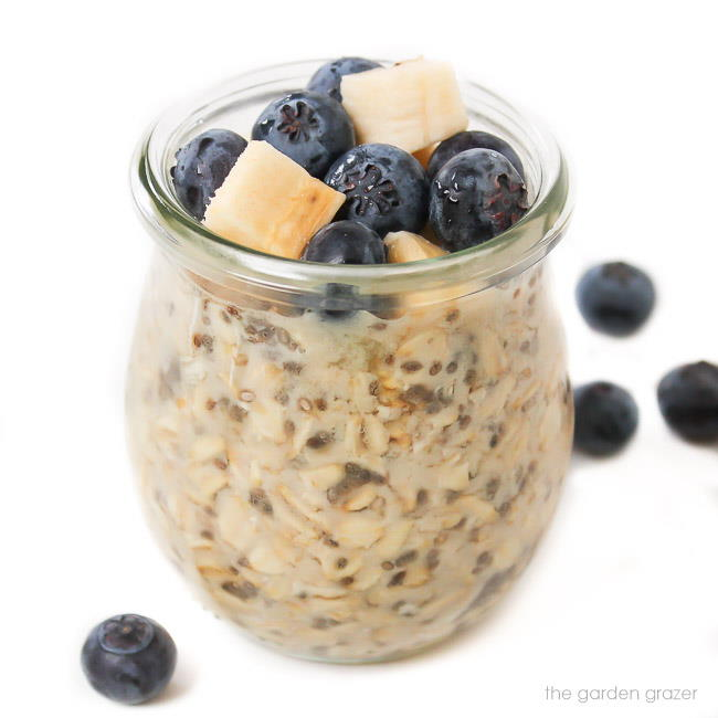 Small jar of vegan overnight oats with blueberries on top