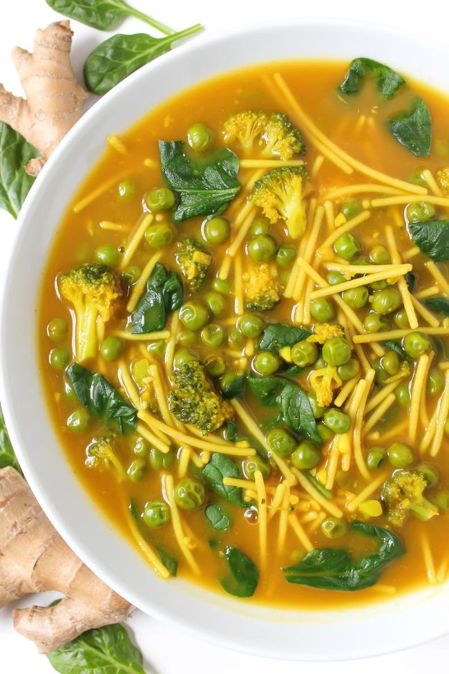 Vegan turmeric noodle soup in a bowl