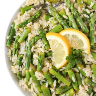 Lemon Garlic Orzo with asparagus in a bowl with spoon
