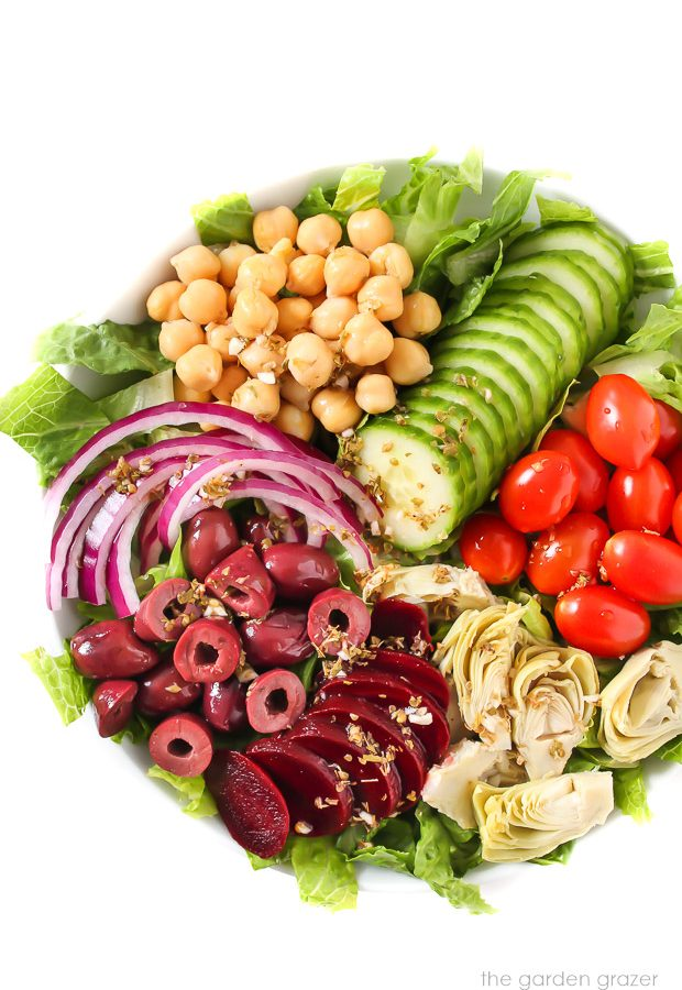 Vegan Greek Salad with dressing poured over top