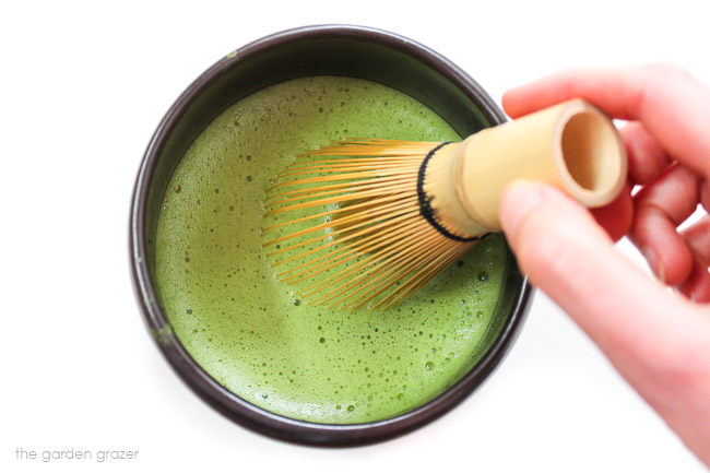 Whisking a hot bowl of matcha green tea