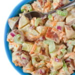 Vegan potato salad in a bowl with spoon