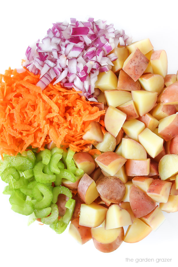 Ingredients for potato salad in a bowl before mixing