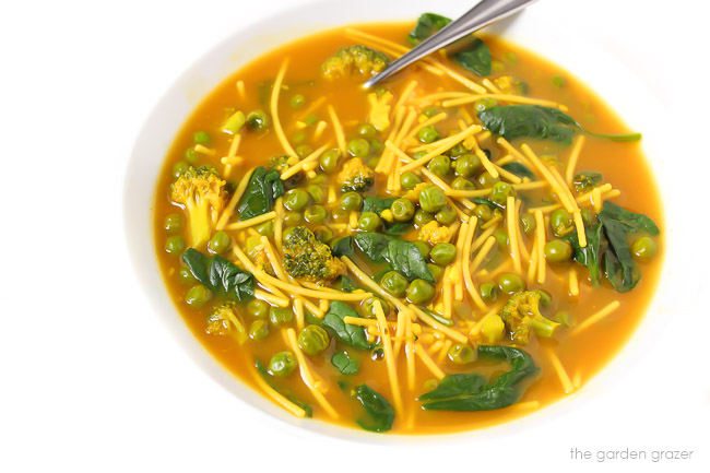 Bowl of vegan turmeric noodle soup