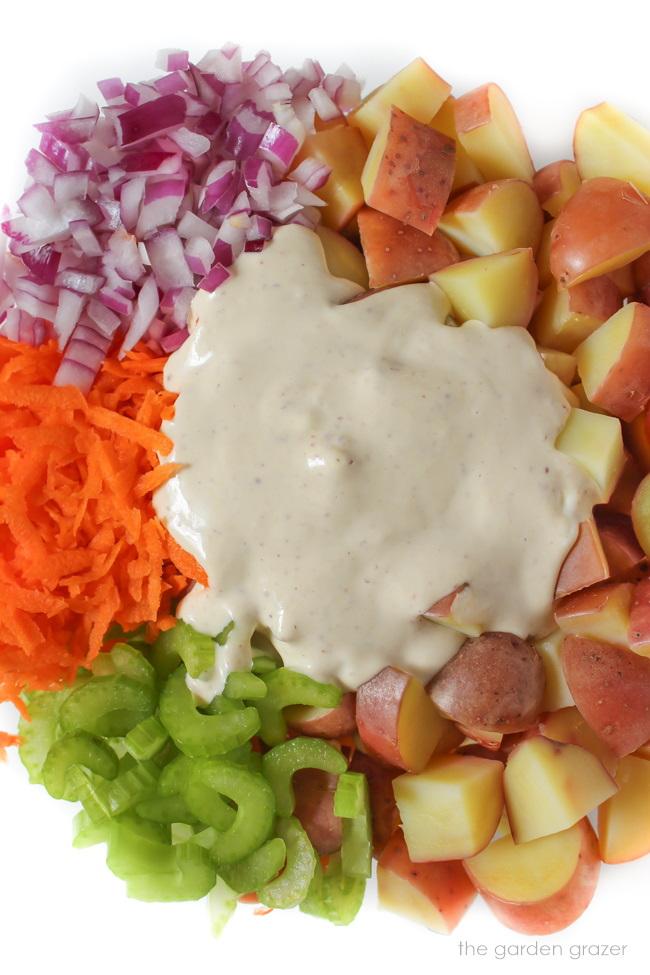 Ingredients for vegan potato salad prepared in a bowl