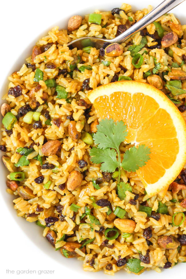 Bowl of curried rice salad with fresh orange