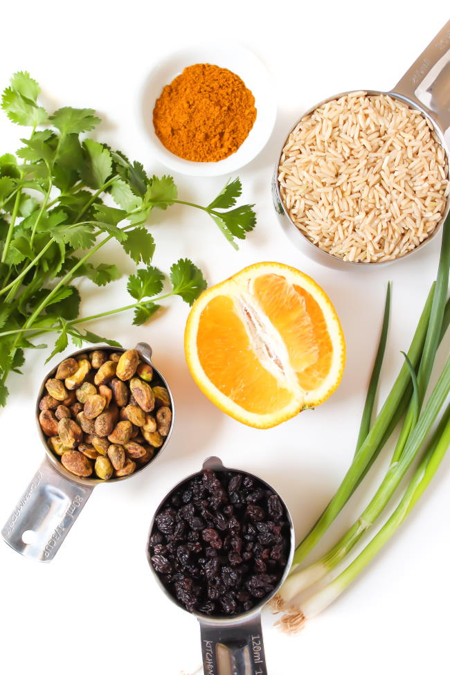Ingredients on a table for curried rice salad with orange