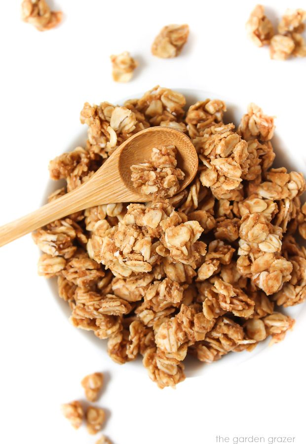Bowl of peanut butter granola with small spoon