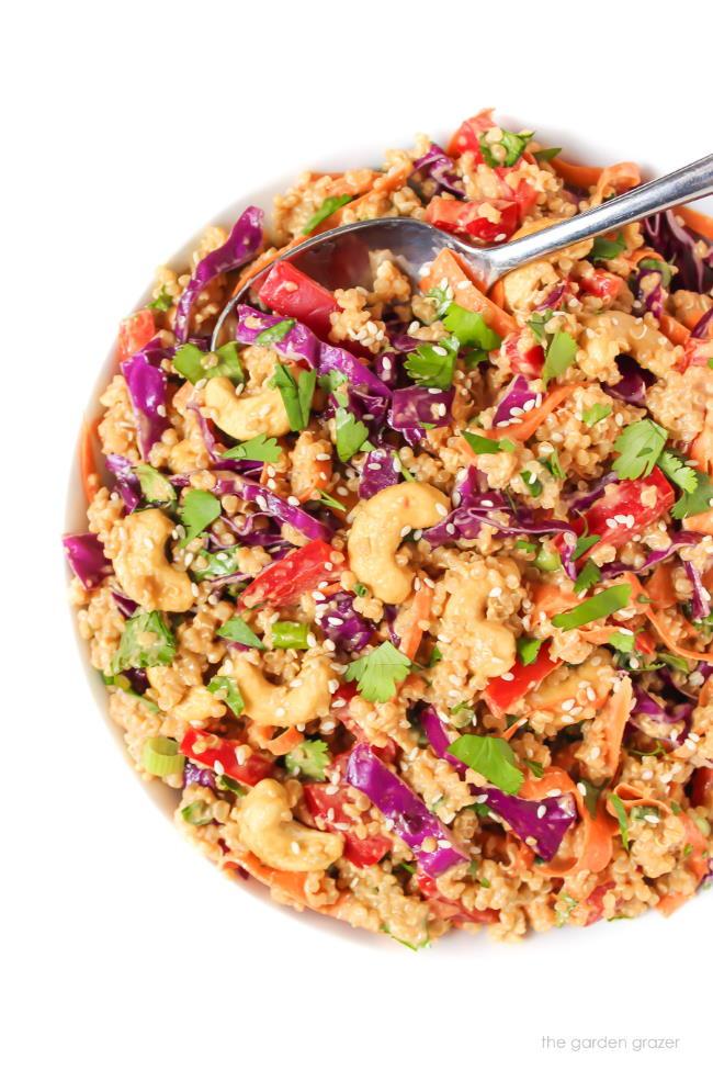 Bowl of Thai Inspired Quinoa Salad with peanut sauce