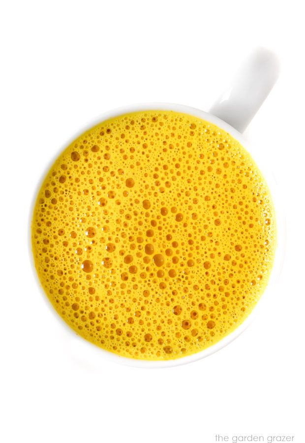 Mug of bright yellow vegan turmeric milk