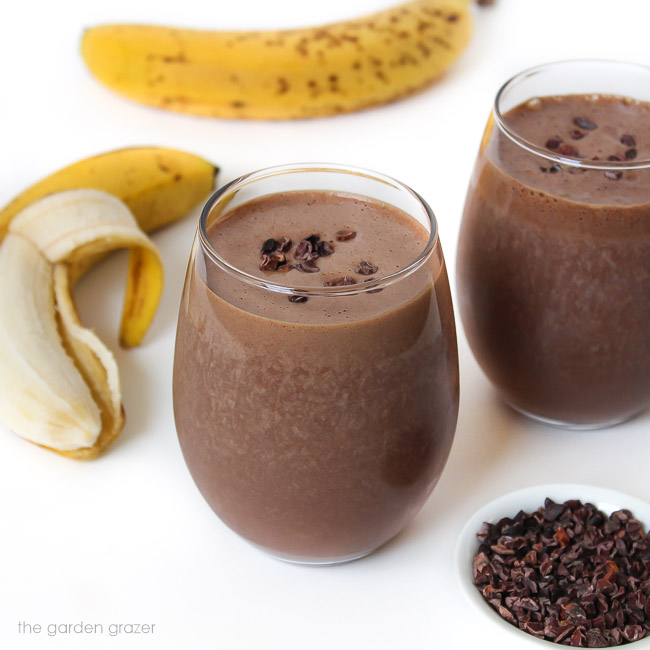 Two glasses of chunky monkey smoothie with banana and cacao