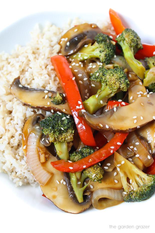 Vegan mushroom stir fry on a plate with brown rice