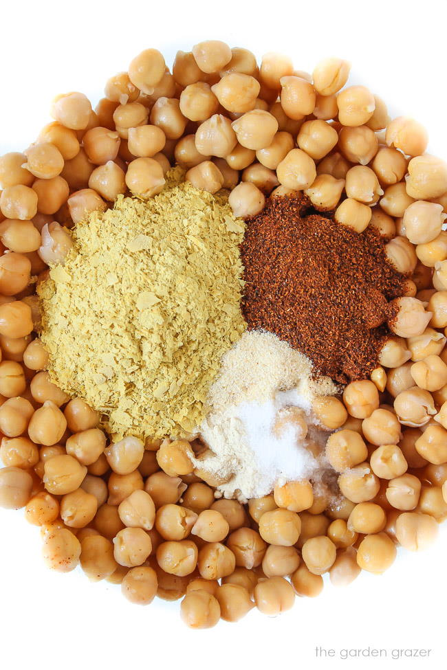 Ingredients in a bowl for cheesy nacho chickpeas