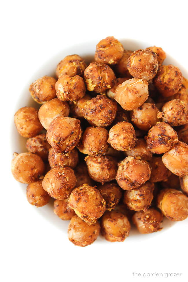 Close up of nacho roasted chickpeas in a small bowl