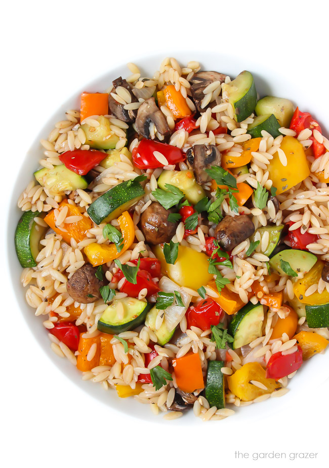 Bowl of orzo tossed with roasted vegetables