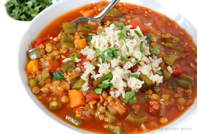 Bowl of lentil stuffed pepper soup with a spoon
