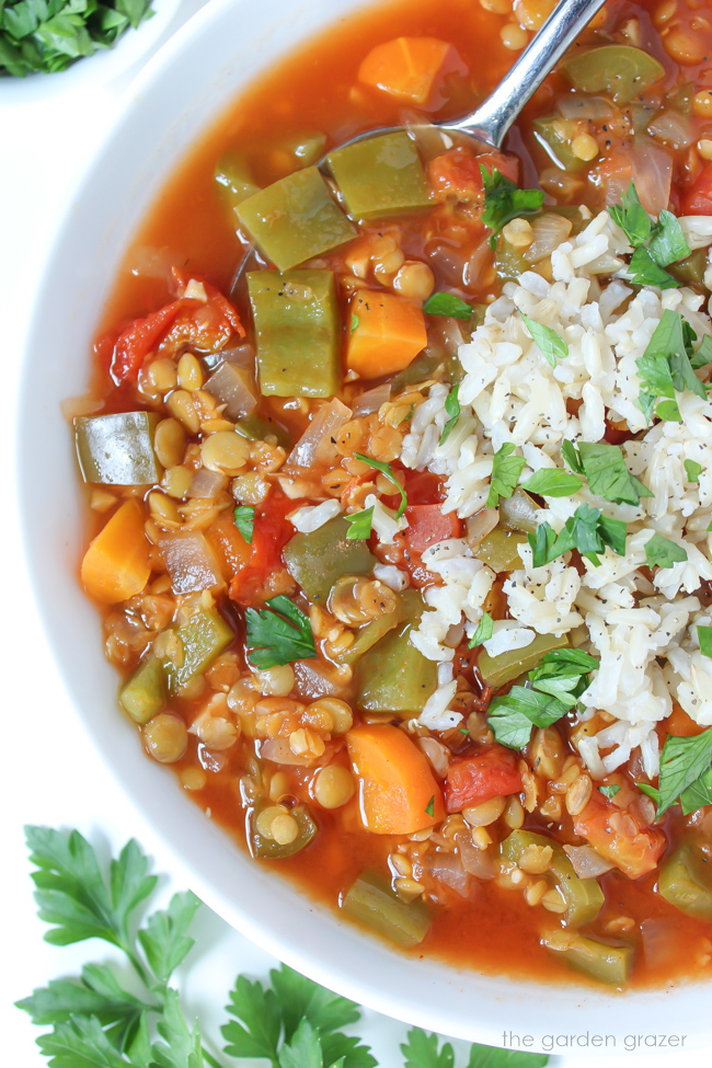 Bowl of stuffed pepper soup with brown rice and spoon