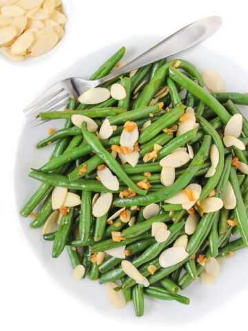 Almond green beans on a plate with fork
