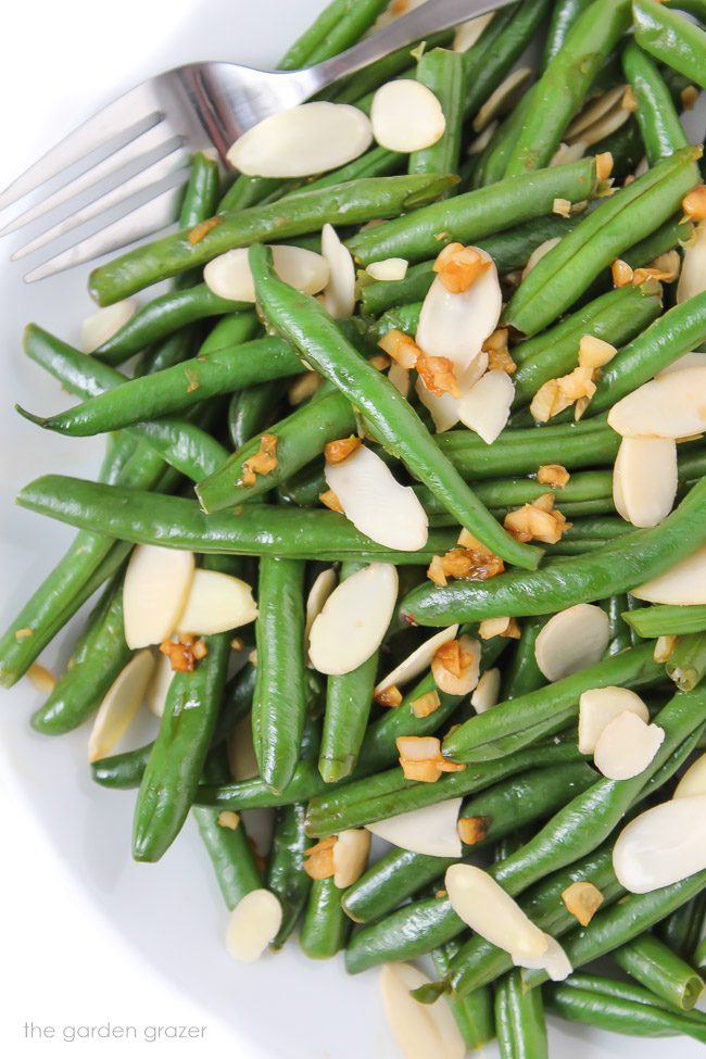 Almond Garlic Green Beans on a plate with fork
