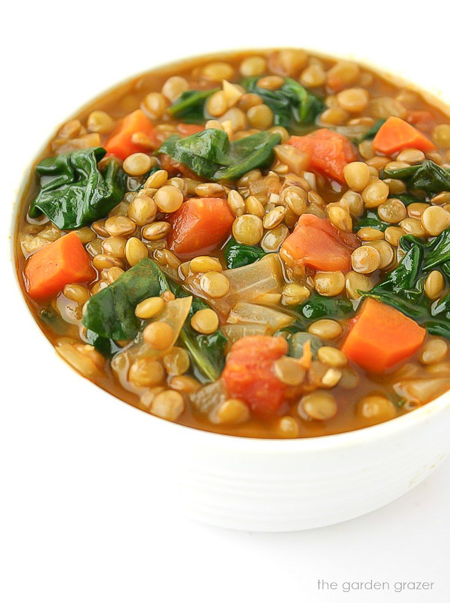 Bowl of vegan lentil spinach soup