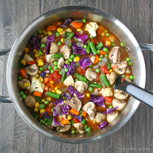 Large stockpot with colorful vegetable soup