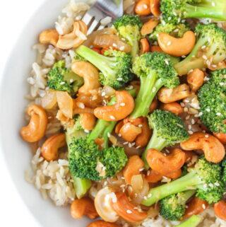 Bowl of vegan cashew stir fry with broccoli