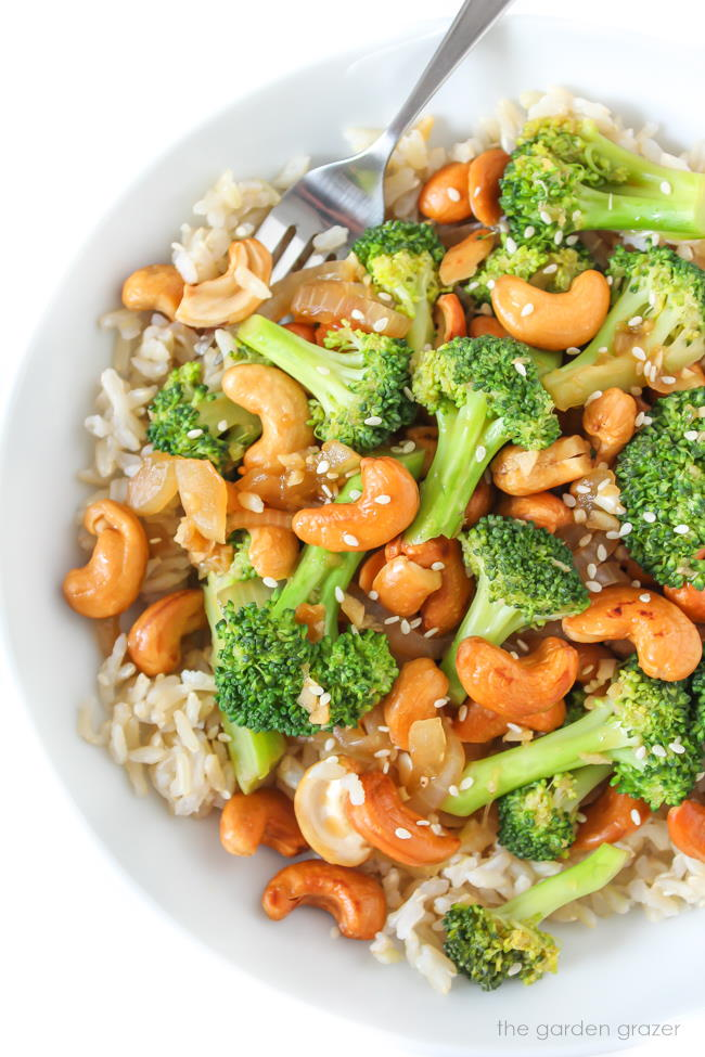 Bowl of vegan cashew stir fry with broccoli