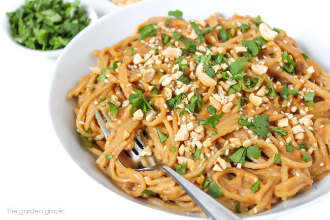 Creamy Peanut Butter Noodles in a bowl topped with cilantro