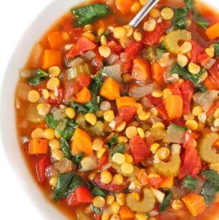 Bowl of Vegan Split Pea Soup with a spoon