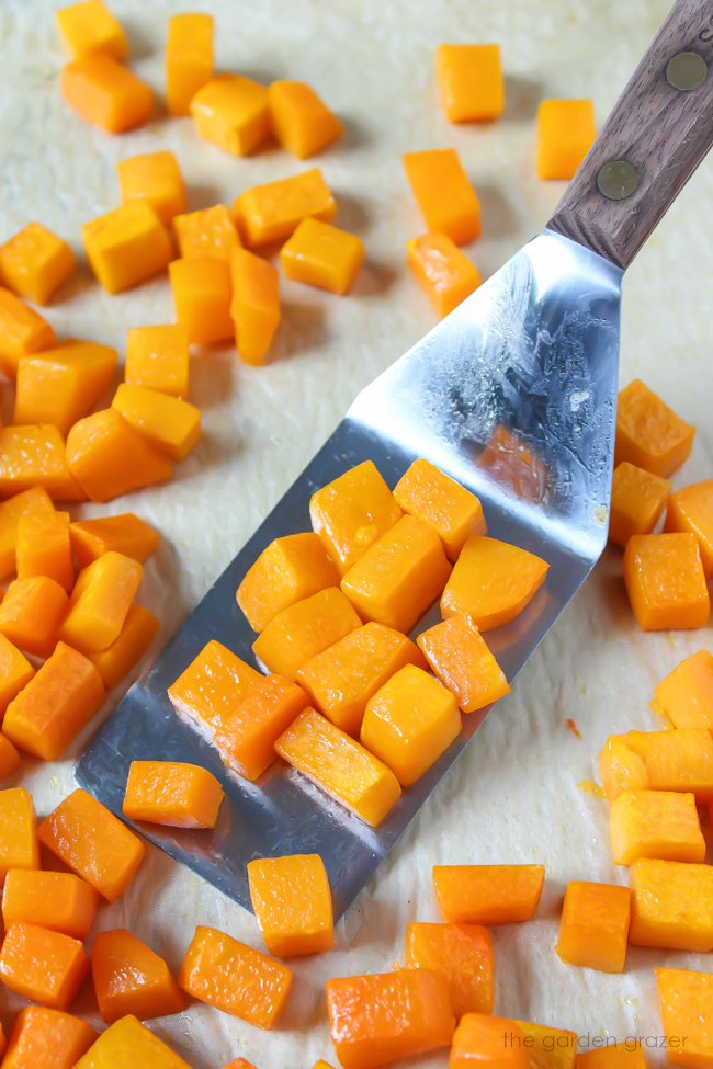 roasted butternut squash cubes on a sheet pan