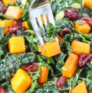 Butternut Squash Kale Salad with fork piercing the salad