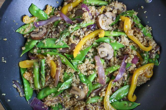 Vegan quinoa stir fry cooking in a wok