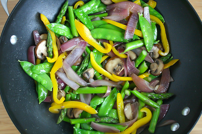 Vegetables cooking in a pan for quinoa stir fry