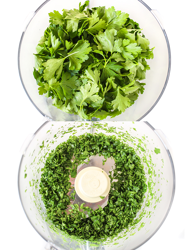 Fresh cilantro being chopped in a food processor