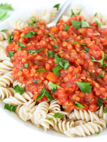 Bowl of pasta with vegan lentil bolognese sauce on top
