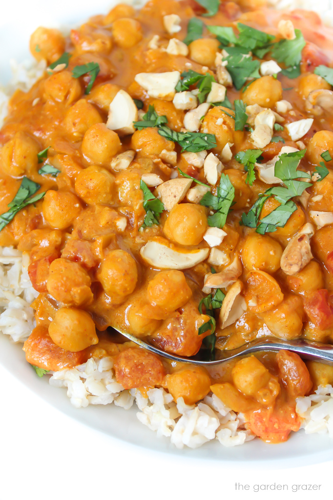Bowl of vegan butter chickpeas and rice with spoon