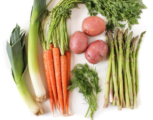 Fresh asparagus, carrots, dill, potatoes, and leeks