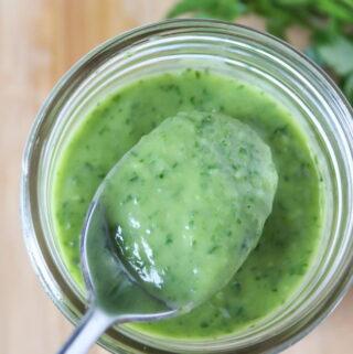 Creamy vegan garden herb dressing in a jar